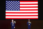 Simone Biles of the United States, right and gold medal, and Jade Carey of the United States, left, and silver medal, listen to the national anthem during the award ceremony for the vault exercise in the women's apparatus finals at the Gymnastics World Championships in Stuttgart, Germany, Saturday, Oct. 12, 2019. (AP Photo/Matthias Schrader)