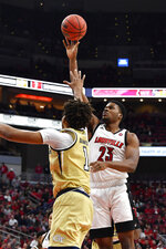 Louisville center Steven Enoch (23) shoots over Georgia Tech guard Jordan Usher (1) during the second half of an NCAA college basketball game in Louisville, Ky., Wednesday, Jan. 22, 2020. Louisville won 68-64. (AP Photo/Timothy D. Easley)