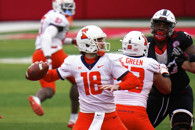 Illinois quarterback Brandon Peters (18) throws behind the block from offensive lineman Kendrick Green (53) during the first half of an NCAA college football game against Nebraska in Lincoln, Neb., Saturday, Nov. 21, 2020. (AP Photo/Nati Harnik)