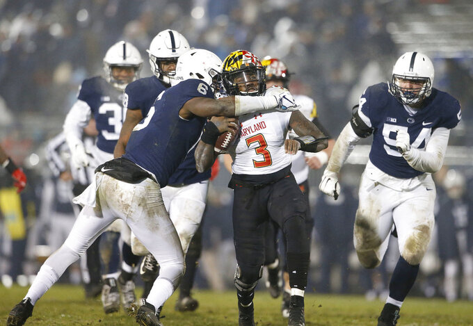 Penn State's Cam Brown (6) tackles Maryland quarterback Tyrrell Pigrome (3) during the second half of an NCAA college football game in State College, Pa., Saturday, Nov. 24, 2018. Penn State won 38-3. (AP Photo/Chris Knight)