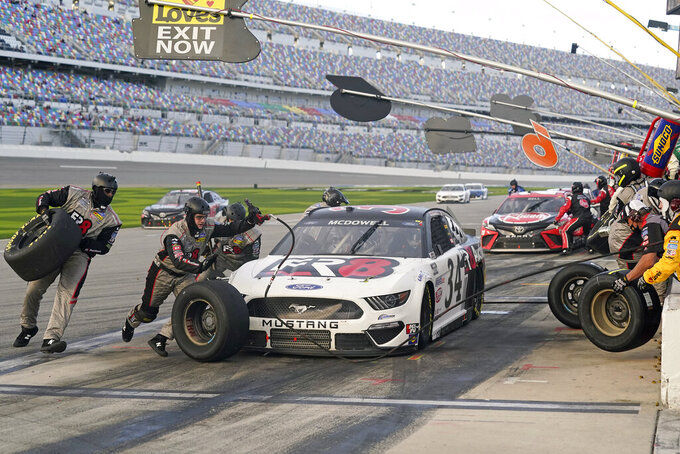 FILE - Michael McDowell makes a pit stop for fuel and tires during the NASCAR Cup Series road course auto race at Daytona International Speedway in Daytona Beach, Fla., in this Sunday, Feb. 21, 2021, file photo. Michael McDowell followed his Daytona 500 victory with a pair of top-10 finishes. That's three in three races, one shy of his total from all of 2020. Perhaps his Front Row Motorsports team really has turned the corner. (AP Photo/John Raoux, File)