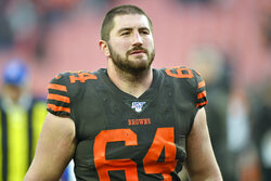 FILE - In this Dec. 8, 2019, file photo, Cleveland Browns center JC Tretter walks off the field after an NFL football game against the Cincinnati Bengals in Cleveland. On Tuesday, March 10, 2020, in the midst of some 2,500 union members voting on a CBA, Tretter was elected as the new NFL Players Association's president, replacing Eric Winston, who no longer is eligible for the position. (AP Photo/David Richard, File)