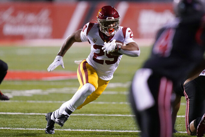 Southern California running back Vavae Malepeai (29) carries the ball during the first half of the team's NCAA college football game against Utah on Saturday, Nov. 21, 2020, in Salt Lake City. (AP Photo/Rick Bowmer)