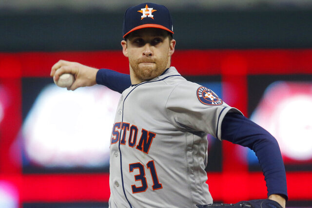 FILE - In this May 1, 2019, file photo, Houston Astros pitcher Collin McHugh throws against the Minnesota Twins in the first inning of a baseball game in Minneapolis. McHugh agreed to a $600,000, one-year contract with the pitching-needy Boston Red Sox, a deal that allows him earn up to $4.25 million. (AP Photo/Jim Mone, File)