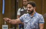 Wasseim Daragmih makes a victim impact statement during the sentencing hearing for Australian Brenton Harrison Tarrant at the Christchurch High Court after Tarrant pleaded guilty to 51 counts of murder, 40 counts of attempted murder and one count of terrorism in Christchurch, New Zealand, Tuesday, Aug. 25, 2020. More than 60 survivors and family members will confront the New Zealand mosque gunman this week when he appears in court to be sentenced for his crimes in the worst atrocity in the nation's modern history. (John Kirk-Anderson/Pool Photo via AP)