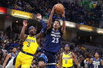 Minnesota Timberwolves guard Jarrett Culver (23) shoots next to Indiana Pacers guard Aaron Holiday (3) during the first half of an NBA basketball game in Indianapolis, Friday, Jan. 17, 2020. (AP Photo/Michael Conroy)