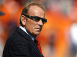 FILE - In this Oct. 7, 2007, file photo, Denver Broncos owner Pat Bowlen looks on during pre-game warmups before the Broncos play the San Diego Chargers in an NFL football game in Denver. The late Pat Bowlen will be inducted into the Pro Football Hall of Fame in Canton, Ohio on Aug. 3, 2019. (AP Photo/David Zalubowski, File)