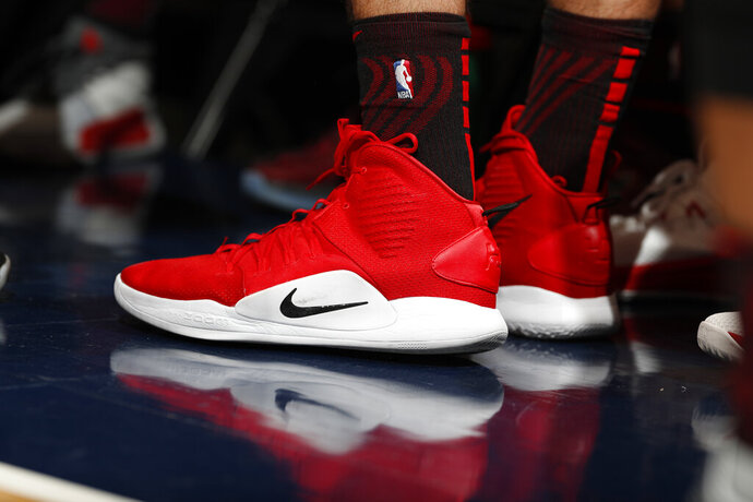 FILE - In this Jan. 13, 2019, file photo Portland Trail Blazers forward Zach Collins (33) wears a pair of Nike Hyperdunks in the first half of an NBA basketball game in Denver. Nike is ending a sales partnership with Amazon less than a month after the athletic gear company named e-commerce veteran John Donahoe as its new CEO.   (AP Photo/David Zalubowski, File)