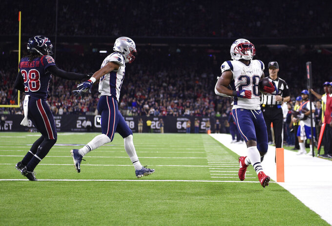 New England Patriots running back James White (28) scores a touchdown against the Houston Texans during the second half of an NFL football game Sunday, Dec. 1, 2019, in Houston. (AP Photo/Eric Christian Smith)