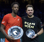 Gael Monfils of France holds the trophy as he celebrates winning against Stan Wawrinka of Switzerland, right, in three sets, 6-3, 1-6, 6-2, in the men's singles final of the ABN AMRO world tennis tournament at Ahoy Arena in Rotterdam, Netherlands, Sunday, Feb. 17, 2019. (AP Photo/Peter Dejong)