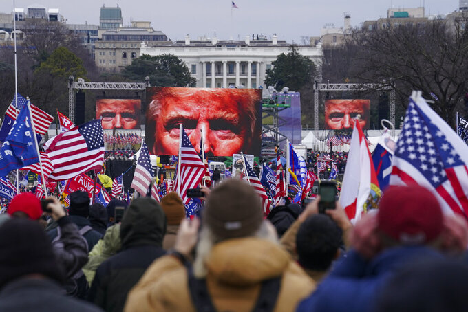 FILE - In this Jan. 6, 2021 file photo, Trump supporters participate in a rally in Washington. Many of those who stormed the Capitol on Jan. 6 cited falsehoods about the election, and now some of them are hoping their gullibility helps them in court. Attorneys for several defendants facing charges connected to the deadly insurrection say they will raise their client's belief in conspiracy theories and misinformation, either as an explanation for why they did what they did, or as an attempt to create a little sympathy. (AP Photo/John Minchillo, File)