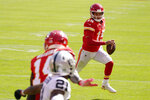 Kansas City Chiefs quarterback Patrick Mahomes (15) scores on a 3-yard touchdown run during the first half of an NFL football game against the Las Vegas Raiders, Sunday, Oct. 11, 2020, in Kansas City. (AP Photo/Charlie Riedel)