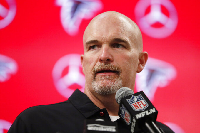 Atlanta Falcons head coach Dan Quinn speaks during a news conference after an NFL football game against the Seattle Seahawks, Sunday, Oct. 27, 2019, in Atlanta. The Seattle Seahawks won 27-20. (AP Photo/John Bazemore)