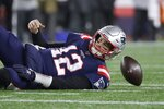 New England Patriots quarterback Tom Brady lands on the turf after being sacked by Kansas City Chiefs defensive end Chris Jones in the second half of an NFL football game, Sunday, Dec. 8, 2019, in Foxborough, Mass. (AP Photo/Elise Amendola)