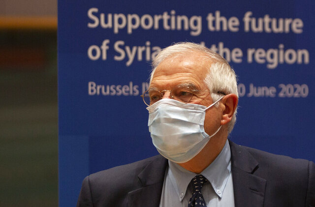 European Union foreign policy chief Josep Borrell waits for the start of a meeting, Supporting the future of Syria and the Region, in videoconference format at the European Council building in Brussels, Tuesday, June 30, 2020. (AP Photo/Virginia Mayo, Pool)