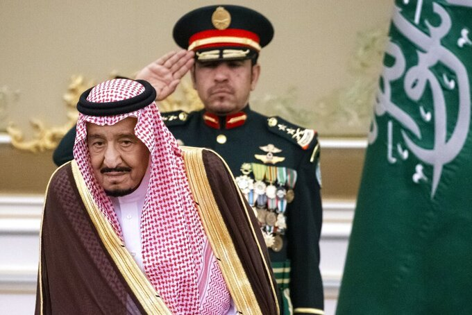 FILE - In this Oct. 14, 2019 file photo, Saudi Arabia's King Salman attends the official welcome ceremony for Russian President Vladimir Putin in Riyadh, Saudi Arabia.  Salman ordered an end to the death penalty for crimes committed by individuals when they were minors, according to a statement Sunday, April 26, 20202, by a top official. The decision comes on the heels of another which orders judges to end the practice of flogging and to issue in its place jail time, fines or community service, bringing to a close one of the kingdom's most controversial forms of public punishment. (AP Photo/Alexander Zemlianichenko, Pool)