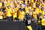 Iowa running back Tyler Goodson (15) celebrates as he scores on a 46-yard touchdown run during the first half of an NCAA college football game against Kent State, Saturday, Sept. 18, 2021, in Iowa City, Iowa. (AP Photo/Charlie Neibergall)