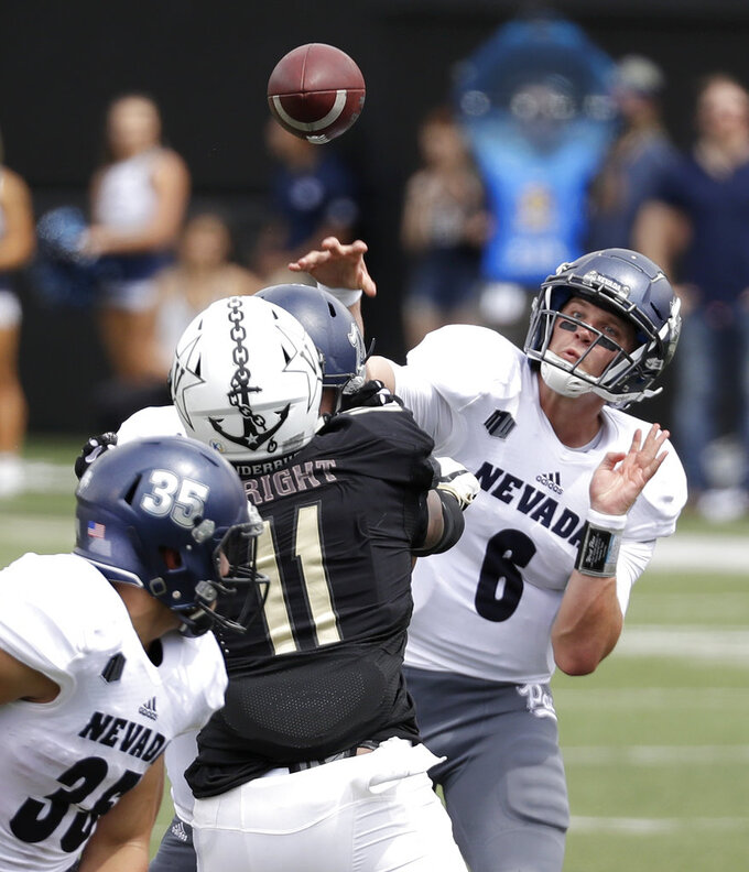Nevada quarterback Ty Gangi (6) throws a pass over Vanderbilt linebacker Charles Wright (11) in the first half of an NCAA college football game Saturday, Sept. 8, 2018, in Nashville, Tenn. (AP Photo/Mark Humphrey)