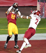 Southern California wide receiver Amon-Ra St. Brown (8) catches a pass in the end zone for a touchdown over Washington State defensive back Derrick Langford (2) in the first half of an NCAA college football game in Los Angeles, Sunday, Dec. 6, 2020. (Keith Birmingham/The Orange County Register via AP)