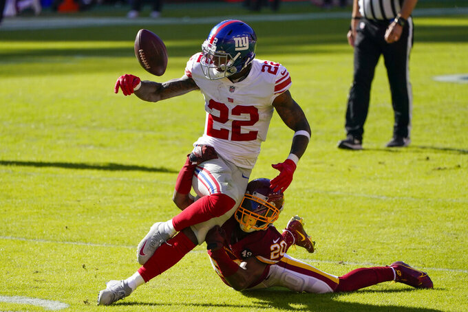 Washington Football Team cornerback Jimmy Moreland (20) breaks up a pass intended for New York Giants running back Wayne Gallman (22) in the first half of an NFL football game between the New York Giants and Washington Football Team, Sunday, Nov. 8, 2020, in Landover, Md. (AP Photo/Al Drago)