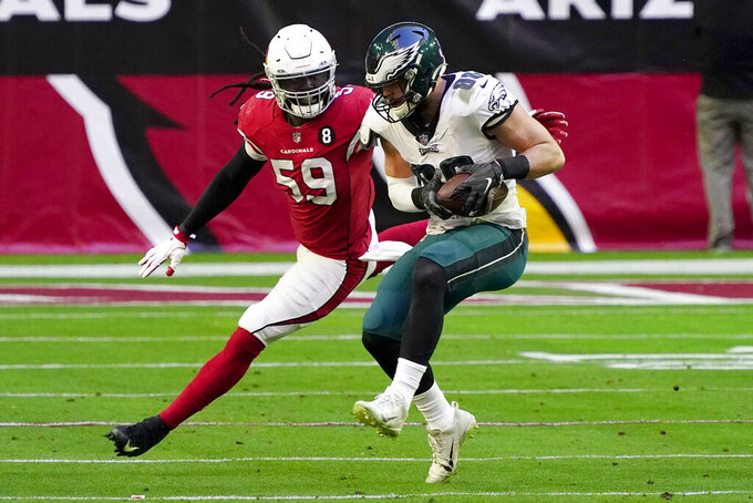 Philadelphia Eagles tight end Dallas Goedert (88) pulls in a pass as Arizona Cardinals outside linebacker De'Vondre Campbell (59) defends during the first half of an NFL football game, Sunday, Dec. 20, 2020, in Glendale, Ariz. (AP Photo/Rick Scuteri)