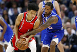 Sacramento Kings forward Trevor Ariza, right, tries to steal the ball from Portland Trail Blazers guard Anfernee Simons during the first quarter of an of an NBA basketball game in Sacramento, Calif., Tuesday, Nov. 12, 2019. (AP Photo/Rich Pedroncelli)