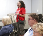 Danielle Twemlow, a gun-control advocate from Topeka, Kan., speaks during a town hall meeting held by U.S. Rep. Steve Watkins, R-Kan., Monday, Aug. 26, 2019, in Topeka, Kan. She wants Watkins to endorse proposals for tougher background checks for firearm purchases and a law allowing authorities to take guns from people deemed a danger to themselves and others. (AP Photo/John Hanna)