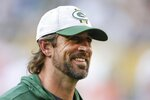 Green Bay Packers' Aaron Rodgers smiles after a preseason NFL football game against the New York Jets Saturday, Aug. 21, 2021, in Green Bay, Wis. The Jets won 23-14. (AP Photo/Matt Ludtke)