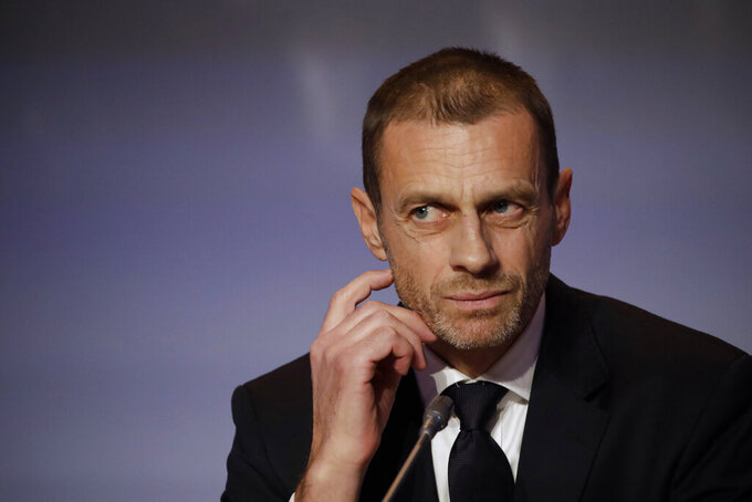 """FILE - In this Thursday, Feb. 7, 2019 file photo, UEFA President Aleksander Ceferin listens to reporter's questions during a press conference at the end of the 43rd UEFA congress in Rome.  Ceferin says he has """"grave concerns"""" about FIFA's plans to stage World Cups every two years and is astonished by the lack of consultation by Gianni Infantino's governing body. The comments were made in a letter to Football Supporters Europe. Ceferin says he backed the group's """"extremely valid and important"""" concerns about the damage doubling the frequency of World Cups would cause to domestic and regional competitions. (AP Photo/Alessandra Tarantino, File)"""