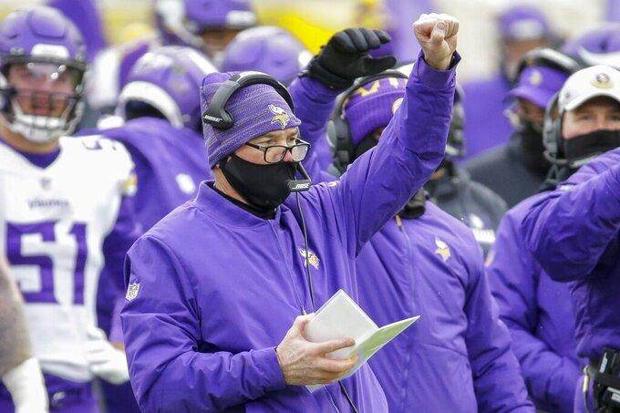 Minnesota Vikings head coach Mike Zimmer calls a play during the first half of an NFL football game against the Green Bay Packers Sunday, Nov. 1, 2020, in Green Bay, Wis. (AP Photo/Mike Roemer)