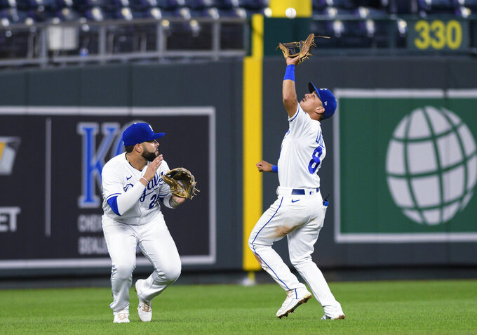 Kansas City Royals shortstop Nicky Lopez (8) avoids colliding with third baseman Emmanuel Rivera while catching a fly ball hit by Cleveland Indians' Daniel Johnson during the seventh inning of a baseball game Tuesday, Aug. 31, 2021, in Kansas City, Mo. (AP Photo/Reed Hoffmann)