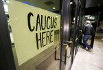 People enter the Democratic caucus at Hempstead High School in Dubuque, Iowa, on Monday, Feb. 3, 2020. (Nicki Kohl/Telegraph Herald via AP)