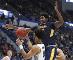 Marquette's Markus Howard (0) controls the ball against Murray State's Darnell Cowart, top, during the first half of a first round men's college basketball game in the NCAA Tournament, Thursday, March 21, 2019, in Hartford, Conn. (AP Photo/Elise Amendola)