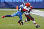 Cleveland Browns running back Nick Chubb (24) carries Tennessee Titans cornerback Malcolm Butler (21) along with him in the second half of an NFL football game Sunday, Dec. 6, 2020, in Nashville, Tenn. (AP Photo/Wade Payne)