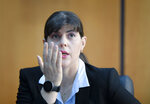 In this photo taken on Friday, Oct. 4, 2019, Laura Codruta Kovesi, Romania's former chief anti-corruption prosecutor who will direct the European Public Prosecutor's Office  (EPPO) - tasked with investigating fraud connected to the use of EU funds and other financial crimes, speaks during an interview with the Associated Press, in Bucharest, Romania. For Kovesi, opposition to her successful candidacy to become the European Union's first chief prosecutor came from a familiar source - her own country's government. Kovesi spent five years as head of the Romanian Anticorruption Directorate and those indicted by her office included 14 Cabinet members, 53 lawmakers and a member of the European Parliament. (AP Photo/Andreea Alexandru)