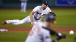 Boston Red Sox starting pitcher Nathan Eovaldi watches a throw to a Baltimore Orioles batter during the first inning of a baseball game in Boston, Wednesday, Sept. 23, 2020, at Fenway Park. (AP Photo/Charles Krupa)