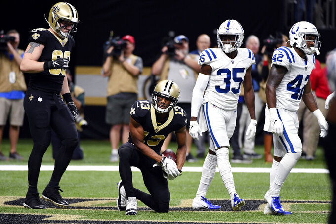 New Orleans Saints wide receiver Michael Thomas (13) reacts after his touchdown reception in the first half of an NFL football game against the Indianapolis Colts in New Orleans, Monday, Dec. 16, 2019. (AP Photo/Bill Feig)