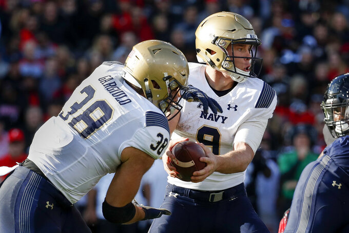 Navy wide receiver Zach Abey (9) moves to hand off the ball to fullback Anthony Gargiulo (38) in the first half of an NCAA college football game against Cincinnati, Saturday, Nov. 3, 2018, in Cincinnati. (AP Photo/John Minchillo)