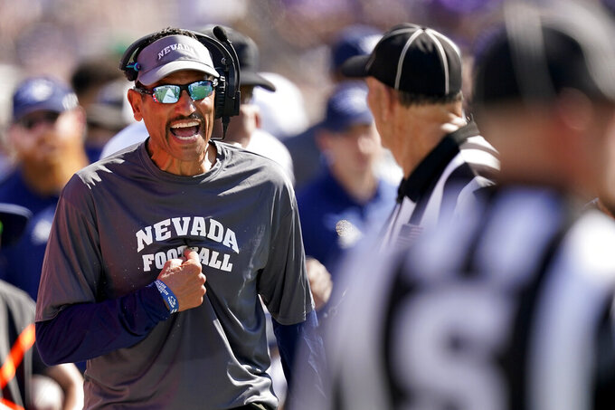 Nevada head coach Jay Norvell talks to officials during the second half of an NCAA college football game against Kansas State Saturday, Sept. 18, 2021, in Manhattan, Kan. (AP Photo/Charlie Riedel)