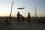 People play Sepak takraw (kick volleyball) on the edge of the runway of the Yangon international airport in Yangon, Myanmar, on Thursday, Jan. 11, 2018. (AP Photo/Thein Zaw)