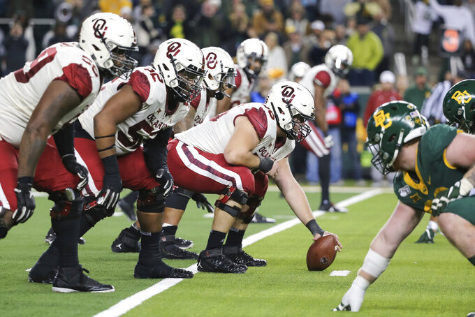FILE - In this Nov. 16, 2019, file photo, Oklahoma offensive lineman Creed Humphrey, center, prepares to snap the ball at the line of scrimmage during an NCAA college football game against Baylor in Waco, Texas. Humphrey was selected to The Associated Press preseason All-America first-team, Tuesday, Aug. 25, 2020. (AP Photo/Ray Carlin, File)