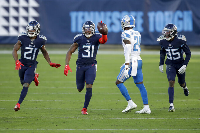 Tennessee Titans free safety Kevin Byard (31) celebrates after scoring against the Detroit Lions during the second half of an NFL football game Sunday, Dec. 20, 2020, in Nashville, Tenn. (AP Photo/Ben Margot)