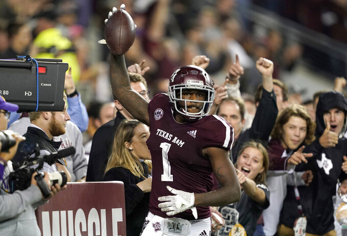 FILE - In this Nov. 24, 2018, file photo, Texas A&M wide receiver Quartney Davis (1) celebrates after catching a touchdown pass during the seventh overtime of an NCAA college football game against LSU, in College Station, Texas. The NCAA Football Rules Committee on Friday, March 12, 2021, recommended a slight change to overtime rules that would require a team to try a two-point conversion after a touchdown when a game reaches the second overtime instead of the third. (AP Photo/David J. Phillip, File)
