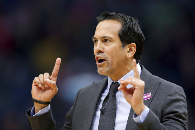 Miami Heat coach Erik Spoelstra questions a referee during the first half of the team's NBA basketball game against the New Orleans Pelicans in New Orleans, Friday, March 6, 2020. (AP Photo/Rusty Costanza)