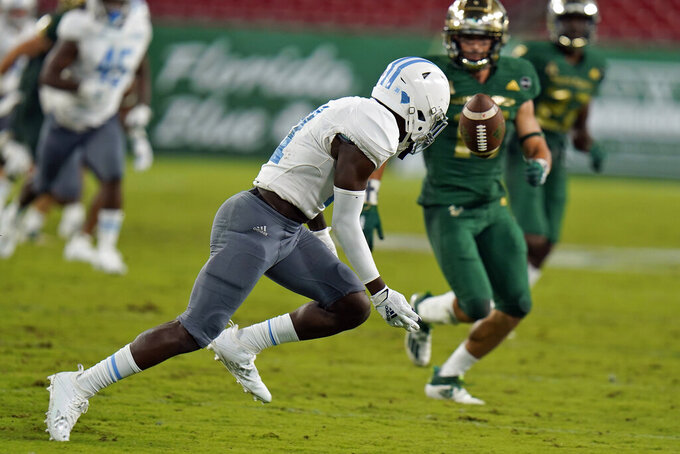 Citadel defensive back Dominick Poole (31) fumbles a punt in front of South Florida defensive back Brock Nichols during the second half of an NCAA college football game Saturday, Sept. 12, 2020, in Tampa, Fla. Nichols recovered the fumble. (AP Photo/Chris O'Meara)
