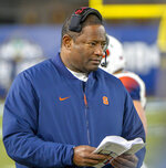 FILE - In this Nov. 17, 2018 file photo, Syracuse head coach Dino Babers watches during an NCAA college football game against Notre Dame at Yankee Stadium in New York. Babers has transformed Syracuse into a winner in three years at the helm. The Orange, who have won nine games and are ranked No. 17, meet No. 15 West Virginia on Friday, Dec. 28, 2018 in the Camping World Bowl. Babers, who just inked a contract extension, feels this is the start of sustained success that could lead to greater heights. (AP Photo/Howard Simmons, File)