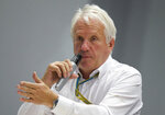 FILE - In this Oct. 10, 2014, file photo, Charlie Whiting, International Automobile Federation, or FIA, Race Director, gestures answering a question during a news conference at the 'Sochi Autodrom' Formula One circuit , in Sochi, Russia. The governing body for international auto racing says its Formula One director Whiting has died from a pulmonary embolism. He was 66. The FIA issued a statement Thursday, March 14, saying Whiting died in Melbourne, where the season-opening Australian Grand Prix will be raced on Sunday.  (AP Photo/Pavel Golovkin, File)
