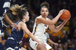 """In this Nov. 23, 2019, photo, Minnesota guard Destiny Pitts (3) lookesto pass the ball as Montana State guard Darian White (2) defends during an NCAA college basketball game in Minneapolis. Pitts said Thursday, Jan. 16, she is transferring after the Gophers suspended her for unspecified """"conduct unbecoming a member of the team."""" (Anthony Souffle/Star Tribune via AP)"""