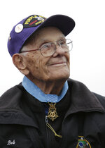 FILE - In this Jan. 15, 2018, file photo, Bob Maxwell, the nation's oldest living Medal of Honor recipient, listens during an unveiling ceremony for the Oregon Medal of Honor Highway sign on U.S. Highway 20, northwest of Bend, Ore. World War II veteran Maxwell has died in Oregon more than seven decades after grabbing a blanket and throwing himself on a German hand grenade in France to save his squad mates. He was 98. Maxwell died Saturday, May 11, 2019, in Bend. U.S. Rep. Greg Walden, a Republican from Oregon, said Maxwell represented the