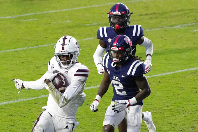 Mississippi State wide receiver Malik Heath (4) hauls in a pass in front of Mississippi defensive back Jalen Jordan (2) during the second half of an NCAA college football game, Saturday, Nov. 28, 2020, in Oxford, Miss. (AP Photo/Rogelio V. Solis)